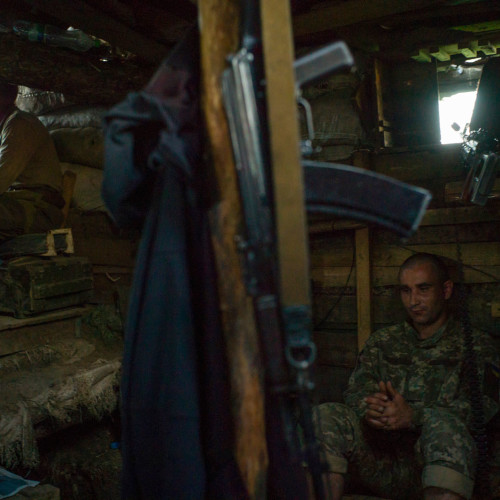 Daily life of Ukrainian soldiers from 54th brygade, 1st batalion, 1st company, based and fighting in the Luganskoye village aera. Soldiers are based in couple of abandoned houses and in tranches outside the village. on picture: soldiers on night watch in a bunker on the post outside the village  14th of July 2016, photo by Wojciech Grzedzinski